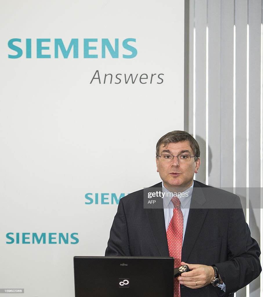 CEO of Siemens Belgium-Luxembourg Andre Bouffioux delivers a speech during the presentation of the group's results for 2012, on January 17, 2013 in Brussels. AFP PHOTO/BELGA LAURIE DIEFFEMBACQ