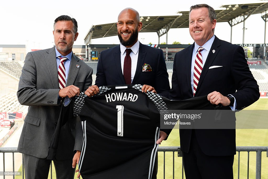 VP of soccer operations Paul Bravo, goalkeeper <a gi-track='captionPersonalityLinkClicked' href=/galleries/search?phrase=Tim+Howard+-+Soccer+Player&family=editorial&specificpeople=11515558 ng-click='$event.stopPropagation()'>Tim Howard</a>, and President Tim Hinchey show off Howard's new jersey as he is introduced as a member of the Colorado Rapids during a press conference at Dick's Sporting Goods Park on June 28, 2016.