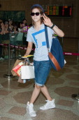 CNU of South Korean boy band B1A4 is seen on departure at Gimpo International Airport on August 26 2013 in Seoul South Korea