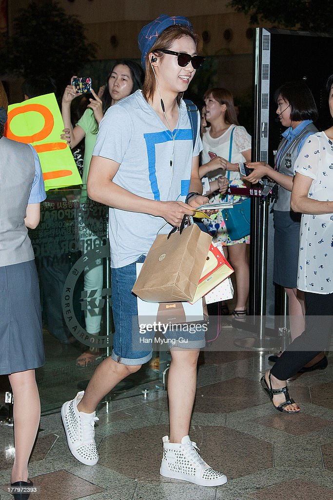 CNU of South Korean boy band B1A4 is seen on departure at Gimpo International Airport on August 26, 2013 in Seoul, South Korea.