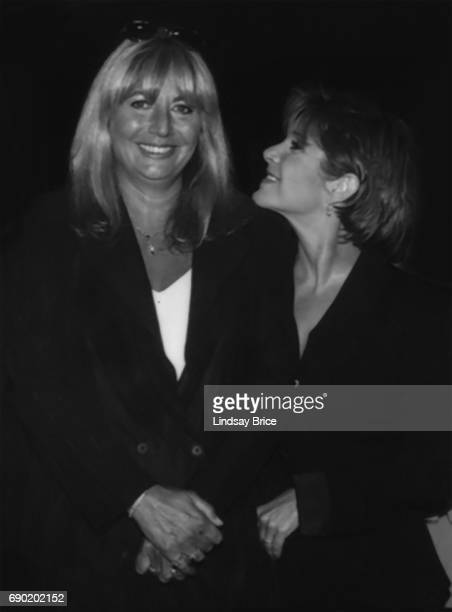 ACLU of Southern California Torch of Liberty Dinner 1995 Carrie Fisher looks to Penny Marshall and smiles at ACLU Torch of Liberty Dinner honoring...
