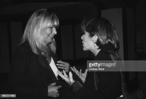 ACLU of Southern California Torch of Liberty Dinner 1995 Penny Marshall listens with amusement to Carrie Fisher at ACLU Torch of Liberty Dinner...