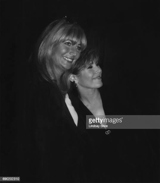 ACLU of Southern California Torch of Liberty Dinner 1995 Penny Marshall and Carrie Fisher lean onto one another and smile at ACLU Torch of Liberty...