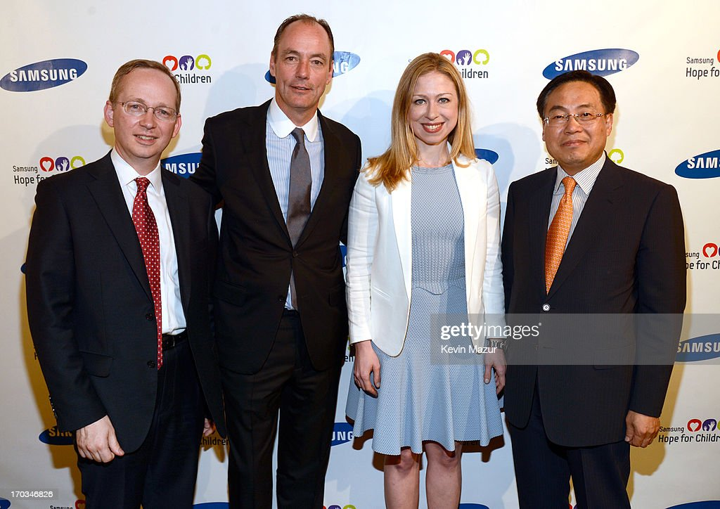 EVP of Strategy Samsung Electronics <a gi-track='captionPersonalityLinkClicked' href=/galleries/search?phrase=David+Steel&family=editorial&specificpeople=220505 ng-click='$event.stopPropagation()'>David Steel</a>, President of Samsung Electronics America Tim Baxter, <a gi-track='captionPersonalityLinkClicked' href=/galleries/search?phrase=Chelsea+Clinton&family=editorial&specificpeople=119698 ng-click='$event.stopPropagation()'>Chelsea Clinton</a> and CEO of Samsung Electronics America YK Kim attend the Samsung's Annual Hope for Children Gala at CiprianiÕs in Wall Street on June 11, 2013 in New York City.