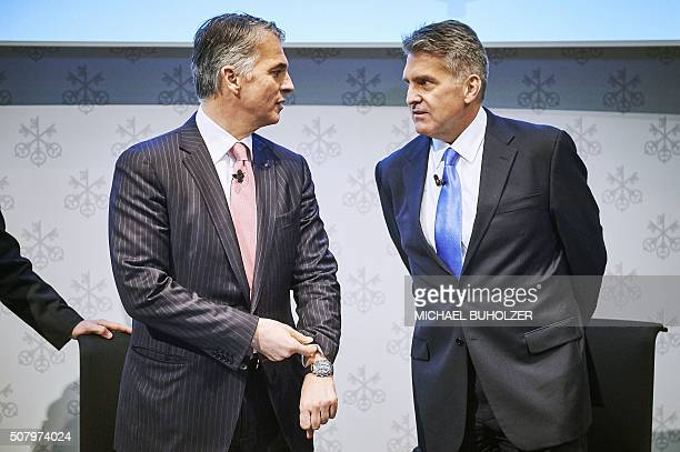 CEO of Swiss banking giant UBS Sergio Ermotti speaks with Group Chief Financial Officer Kirt Gardner during the presentation of UBS's fourth quarter...