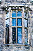 U of T or University of Toronto Trinity College beautiful glass windows with a light blue color The landmark features Jacobethan Tudor architecture