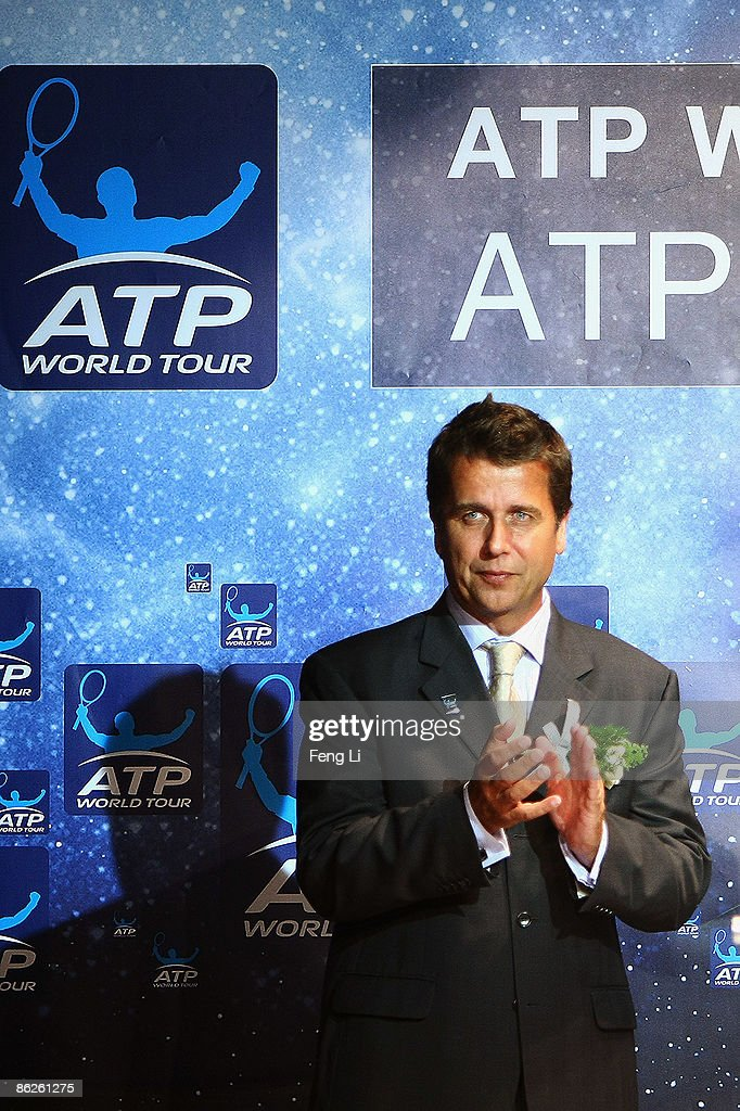 CEO of the ATP International Group Brad Drewett applauds during a press conference at 798 Art Park on April 28 2009 in Beijing China The new ATP...