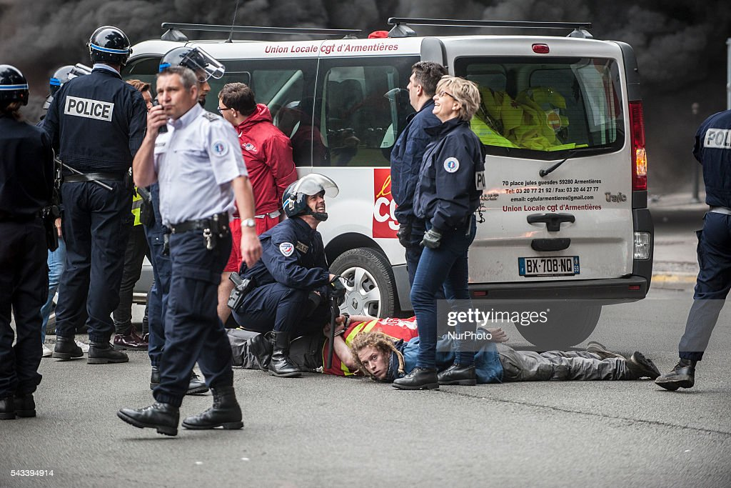 2 of the CGT trade unionists were arrested and flat on the ground after the police intervention around the roundabout Post in Lille, France on june 28, 2016. A new national day of mobilization against the law work takes place throughout France. Economic blocking action was planned by the CGT in Lille this morning at 6:30 am.