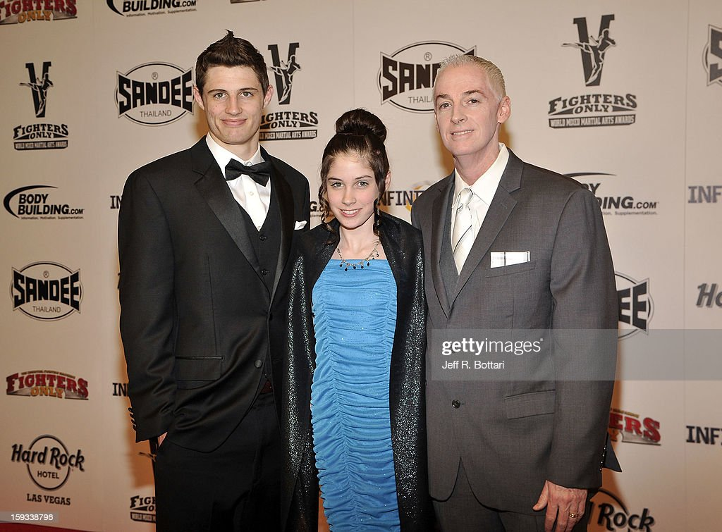 COO of The Gun Store, Chris Irwin (R) arrive with his son Brandon Irwin (L) and his daughter Jenica Irwin (C) at the Fighters Only World Mixed Martial Arts Awards at the Hard Rock Hotel & Casino on January 11, 2013 in Las Vegas, Nevada.