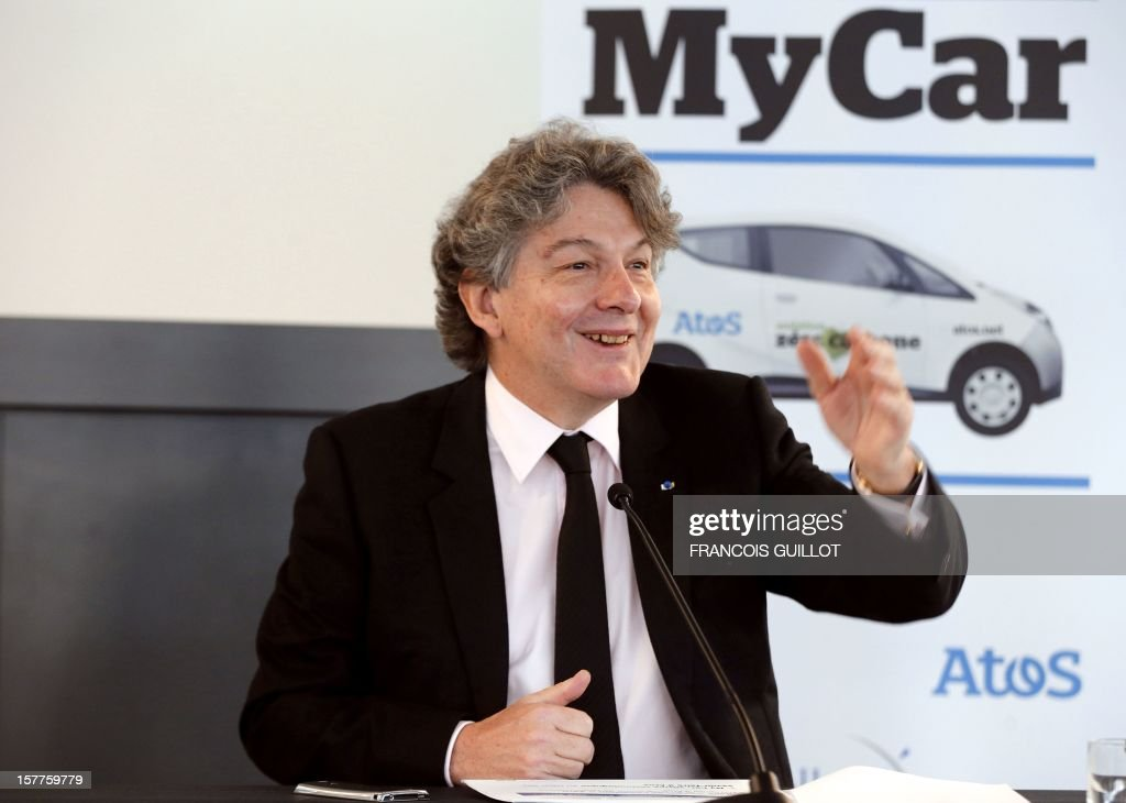 CEO of the IT services company Atos, Thierry Breton speaks during a joint press conference, on December 6, 2012 in Bezons, north of Paris, to announce the launching of My Car, the first Atos electric car fleet powered by solar panels, in partnership with French industrial group Bollore. AFP PHOTO FRANCOIS GUILLOT