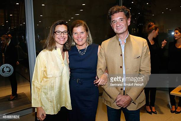 CEO of the 'Jerome Seydoux Pathe Foundation' Sophie Seydoux standing between actress Carole Bouquet and Philippe Sereys de Rothschild attend the...