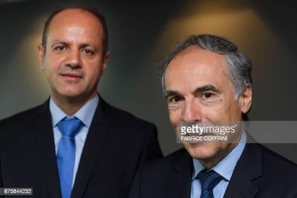 CEO of the London company R Fintech Plc Ignacio Ozcariz and R Fintech Plc head of business development Usama Al Ali pose during the launching of the...