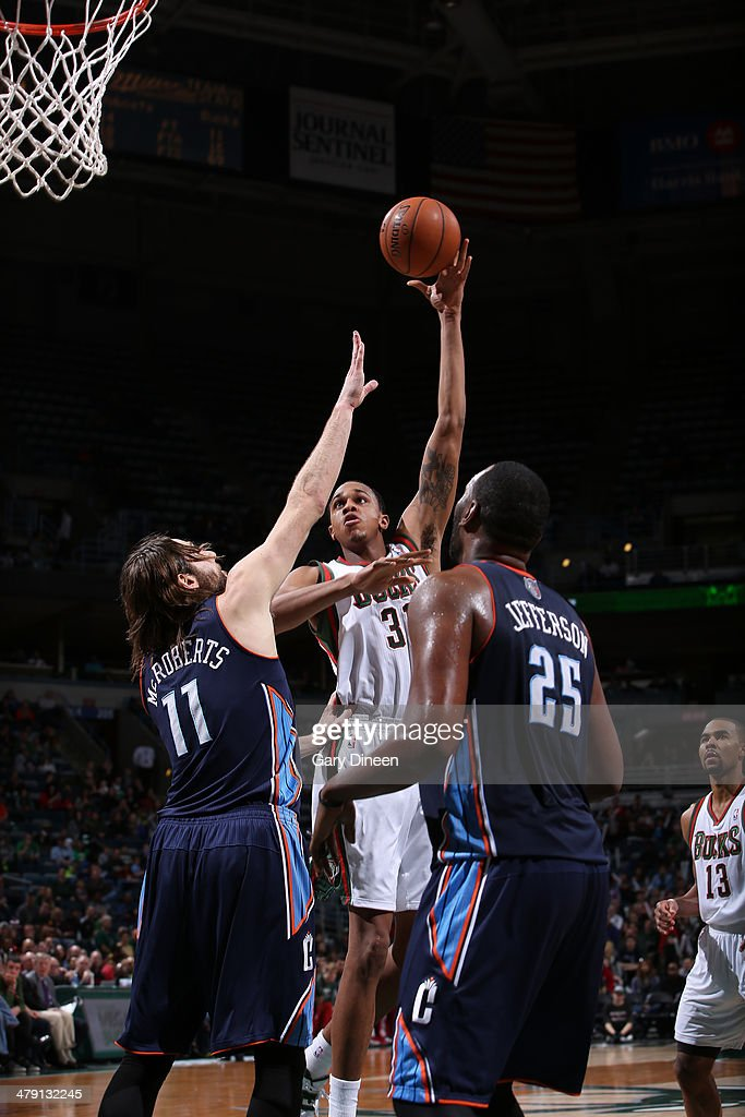 # of the Milwaukee Bucks does something against xx # of the Charlotte Bobcats on March 16, 2014 at the BMO Harris Bradley Center in Milwaukee, Wisconsin.