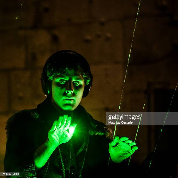 CONDAL of the musical duo 'Kort' plays a laser harp during the city's light festival 'Llum BCN' in Barcelona