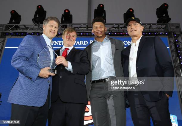 CEO of the NFL's Kansas City Chiefs Clark Hunt sports agent/event host Leigh Steinberg Chairman and football player Patrick Mahomes II pose onstage...