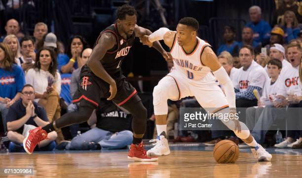 of the Oklahoma City Thunder tries to drive around Patrick Beverley of the Houston Rockets during the first half of Game Three in the 2017 NBA...
