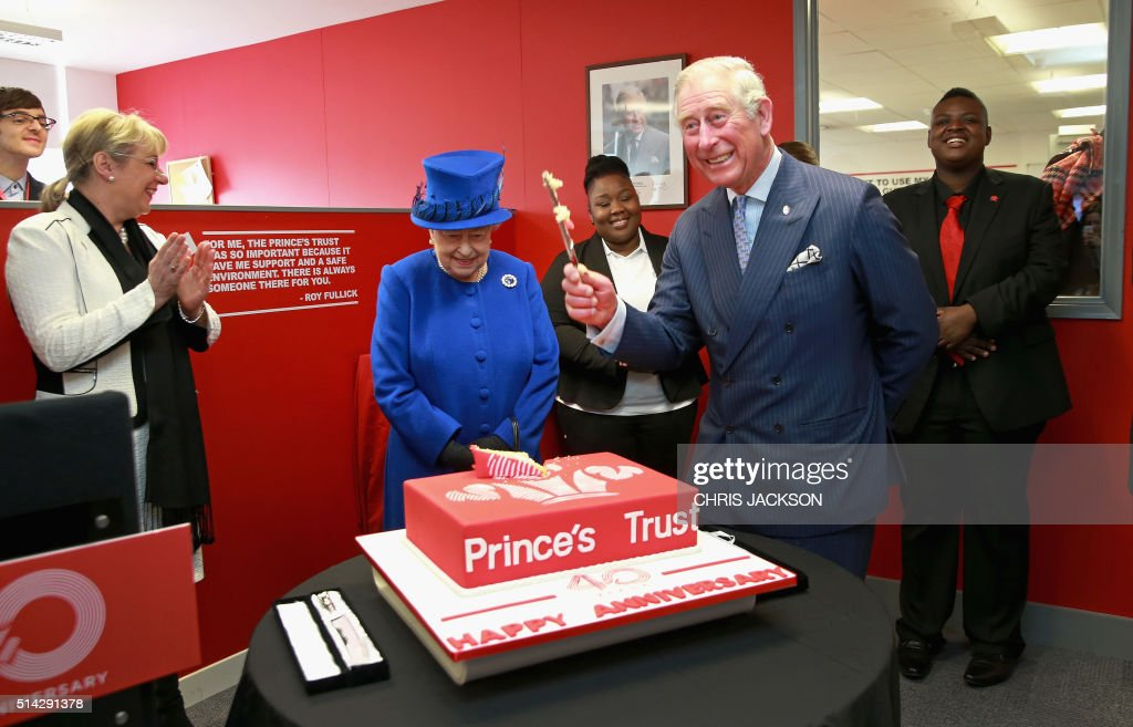 CEO of the Prince's Trust Martina Milburn (L) claps as Britain's Queen Elizabeth II (2L) and Prince Charles, Prince of Wales (2R) cut a 40th anniversary cake during a visit to the Prince's Trust Centre in Kennington in London on March 8, 2016. The Queen was visiting the Centre with Prince Charles, Prince of Wales to mark the 40th Anniversary of the Prince's Trust. TRH's saw the impact the Prince's Trust has on young people and heard about the six programmes run by the Trust to help disadvantaged young people ages 13 to 30 to get into education and employment. / AFP PHOTO / POOL / Chris Jackson