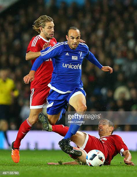 of the Rest of the World rides the tackles from Alan Smith and Phil Neville of Great Britain and Ireland during the David Beckham Match for Children...