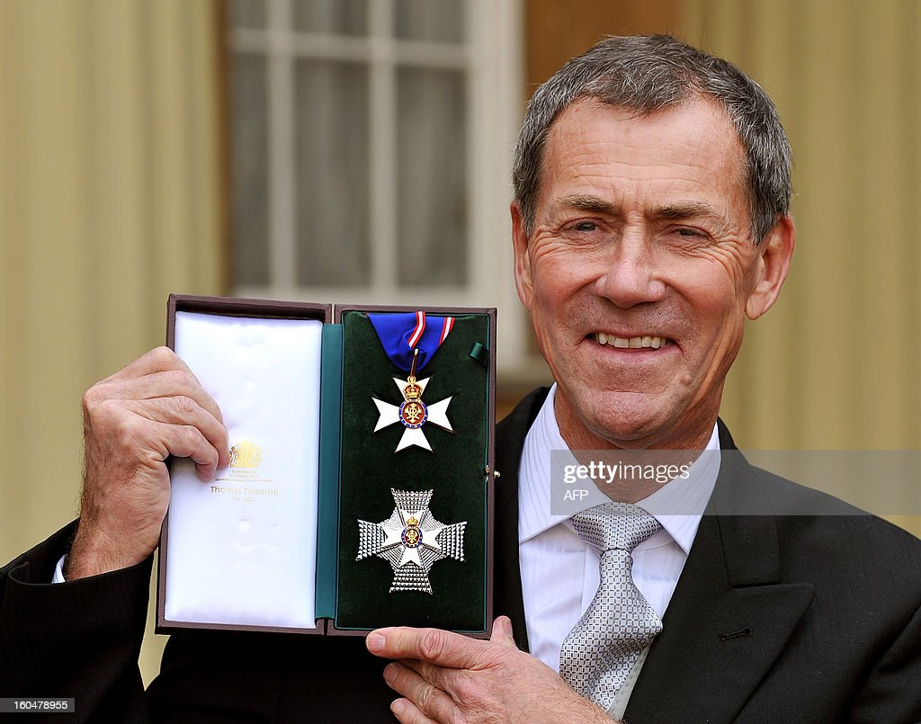 CEO of The Thames Diamond Jubilee Foundation Michael Lockett poses with his insignia of Knight Commander medal after it was presented to her by the Prince of Wales during the Investiture Ceremony at Buckingham Palace in central London on February 1, 2013.