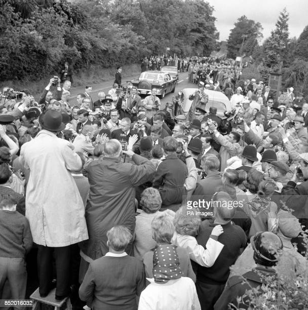KENNEDY of the United States who yesterday flew in from Ireland for a short visit during his European tour is surrounded by a large crowd which had...