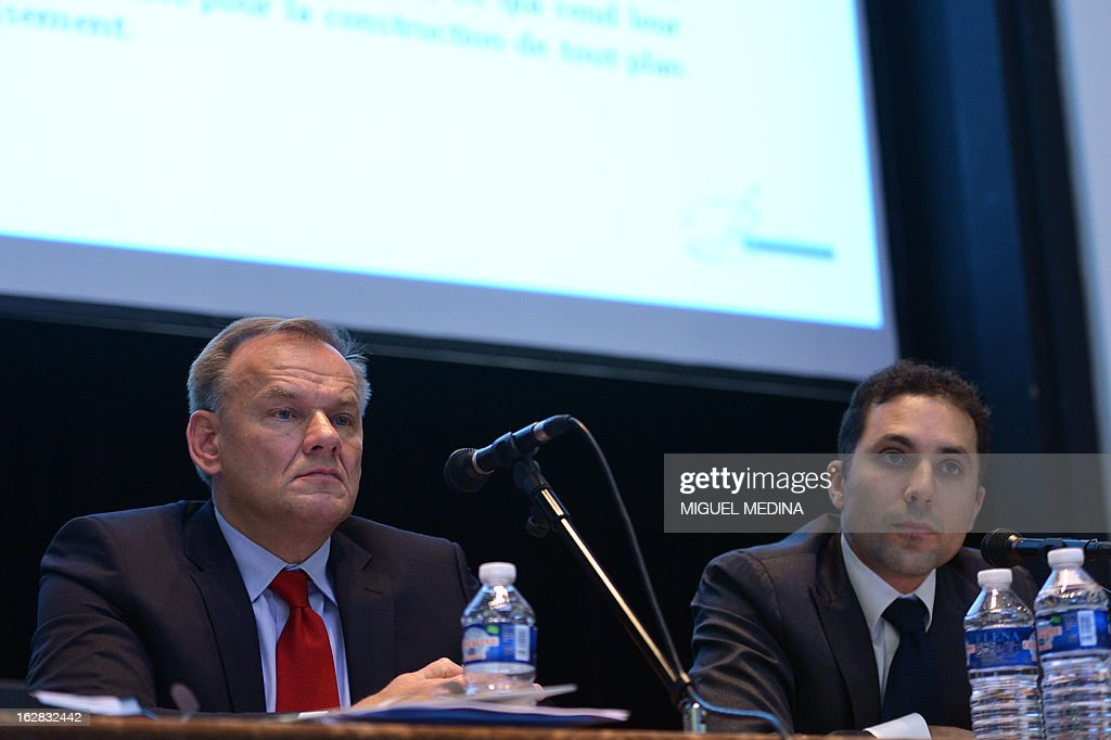 CEO of the wine and spirit company Belvedere, Krystof Trylinski (L) and judicial administrator Frederic Abitbol, attend a group's extraordinary general meeting, on February 28, 2013 in Paris.