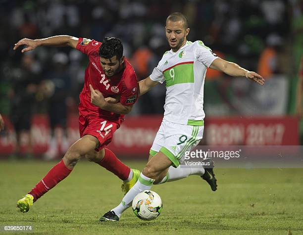 AMOR of Tunisia and SOFIANE HANNI of Algeria during the Group B match between Algeria and Tunisia at Stade Franceville on January 19 2017 in...