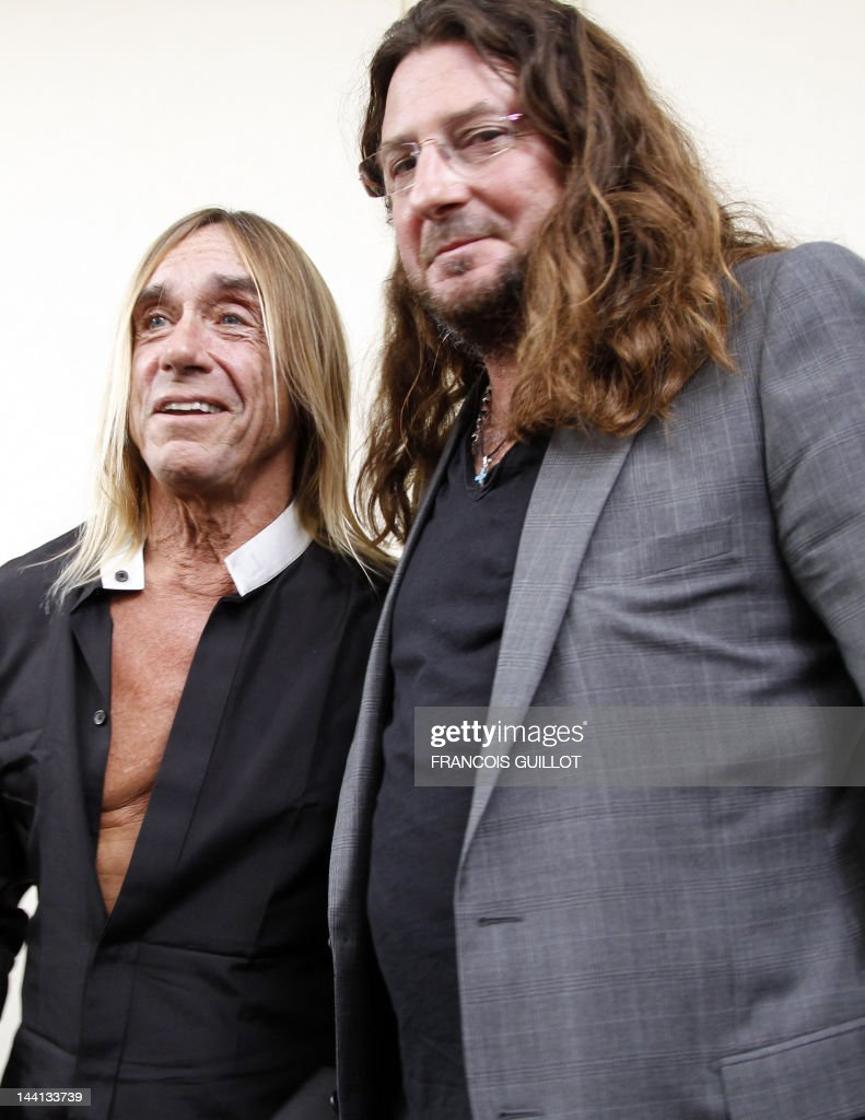 CEO of vente-privee.com Jacques-Antoine Granjon (R) nex to Iggy Pop poses during a press conference to present US singer Iggy Pop's new album 'Après', on May 9, 2012 in Paris. 'Après' ('After' in French) is Iggy Pop's 16th record, with covers of international and French standards (by singers such as Frank Sinatra, The Beatles, Edith Piaf, Serge Gainsbourg, Georges Brassens, Henri Salvador), exclusively on sale on the French online retailer website vente-privee.com, specialising in selling brand overstock and organizing events-based sales.