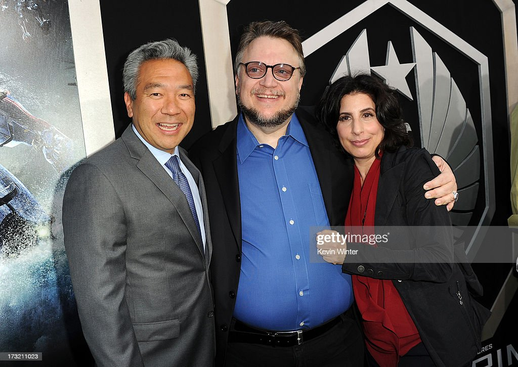 CEO of Warner Bros. Entertainment Kevin Tsujihara, filmmaker Guillermo Del Toro and Warner Bros. Pictures President of Worldwide Marketing and International distribution Sue Kroll arrive at the premiere of Warner Bros. Pictures' and Legendary Pictures' 'Pacific Rim' at Dolby Theatre on July 9, 2013 in Hollywood, California.