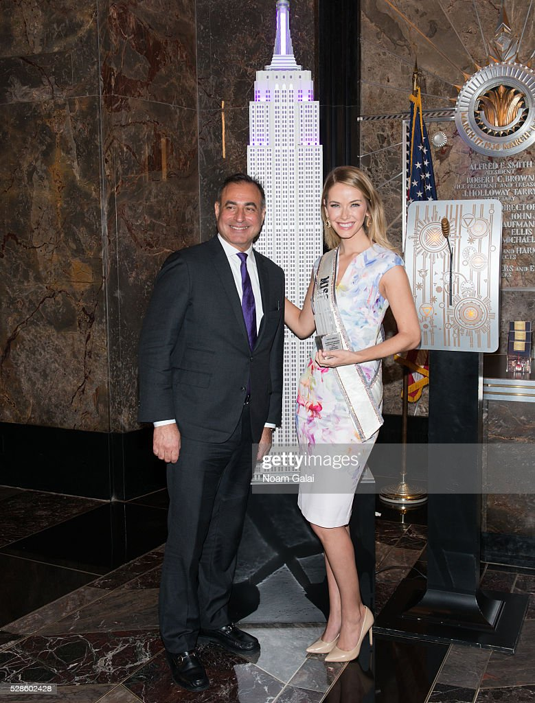 CEO of Welltower Thomas DeRosa and Miss USA 2015 <a gi-track='captionPersonalityLinkClicked' href=/galleries/search?phrase=Olivia+Jordan&family=editorial&specificpeople=9445833 ng-click='$event.stopPropagation()'>Olivia Jordan</a> light the Empire State Building to raise awareness of the Alzheimer's disease on May 06, 2016 in New York, New York.