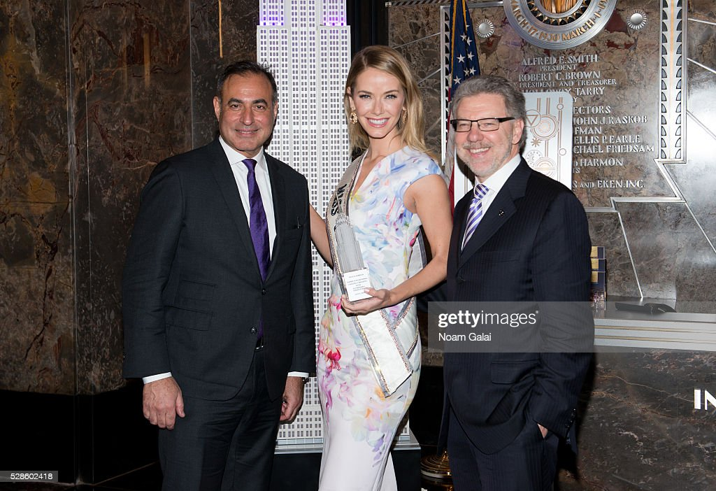 CEO of Welltower Thomas DeRosa, Miss USA 2015 <a gi-track='captionPersonalityLinkClicked' href=/galleries/search?phrase=Olivia+Jordan&family=editorial&specificpeople=9445833 ng-click='$event.stopPropagation()'>Olivia Jordan</a> and CEO of Alzheimer's Association Harry Johns light the Empire State Building to raise awareness of the Alzheimer's disease on May 06, 2016 in New York, New York.