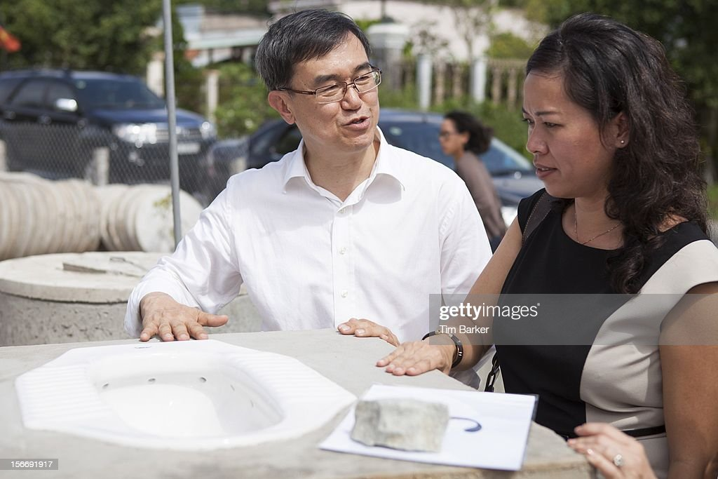 CEO of World Toilet Organisation Mr. Jack Sim talks with Marketing Vice President of Unilever Vietnam Nguyen Thi Bich Va at a toilet production center as part of a media briefing on World Toilet Day on November 19, 2012 in Vinh Long, Vietnam.