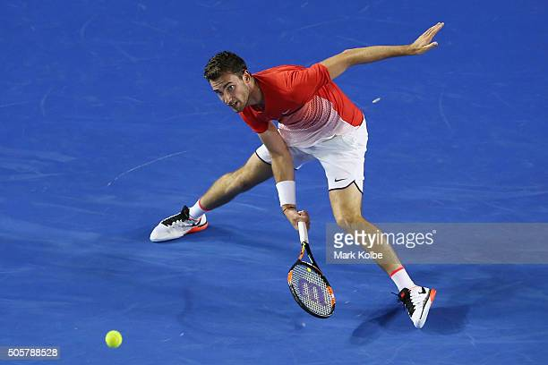 XXX of ZZZ plays a forehand in his/her second round match against XXXX of ZZZZ during day three of the 2016 Australian Open at Melbourne Park on...