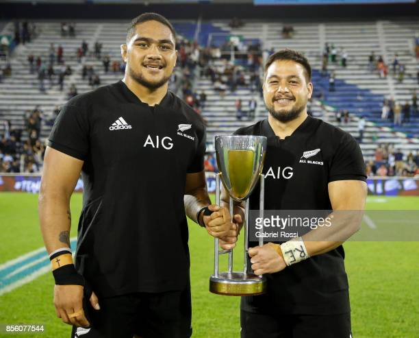 Ofa Tu'ungafasi and Nepo Ngani Laumape of New Zealand pose with the trophy after a match between Argentina and New Zealand as part of Rugby...