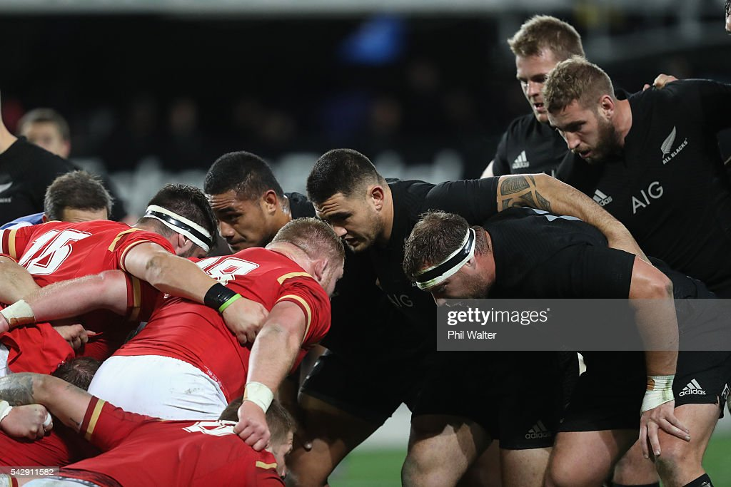 Ofa Tu'ungafasi, Codie Taylor and <a gi-track='captionPersonalityLinkClicked' href=/galleries/search?phrase=Wyatt+Crockett&family=editorial&specificpeople=699696 ng-click='$event.stopPropagation()'>Wyatt Crockett</a> pack down in the front row during the International Test match between the New Zealand All Blacks and Wales at Forsyth Barr Stadium on June 25, 2016 in Dunedin, New Zealand.