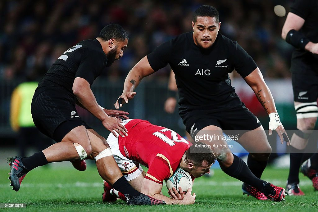 Ofa Tu'ungafasi of New Zealand looks to tackle Gareth Davies of Wales during the International Test match between the New Zealand All Blacks and Wales at Forsyth Barr Stadium on June 25, 2016 in Dunedin, New Zealand.