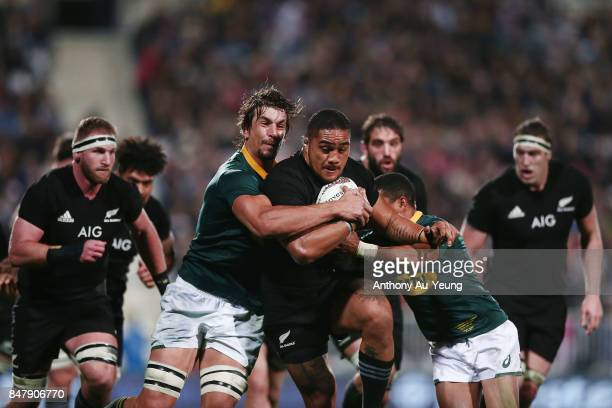 Ofa Tu'ungafasi of the All Blacks on the charge against Rudy Paige and Eben Etzebeth of South Africa during the Rugby Championship match between the...