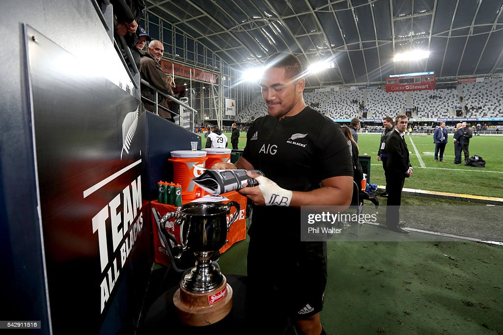 Ofa Tu'ungafasi of the All Blacks signs autographs during the International Test match between the New Zealand All Blacks and Wales at Forsyth Barr Stadium on June 25, 2016 in Dunedin, New Zealand.