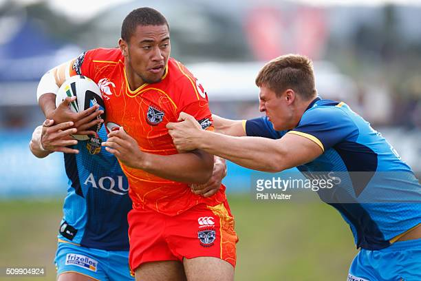 Ofahiki Ogden of the Warriors is tackled during the NRL Trial Match between the New Zealand Warriors and the Gold Coast Titans at Toll Stadium on...