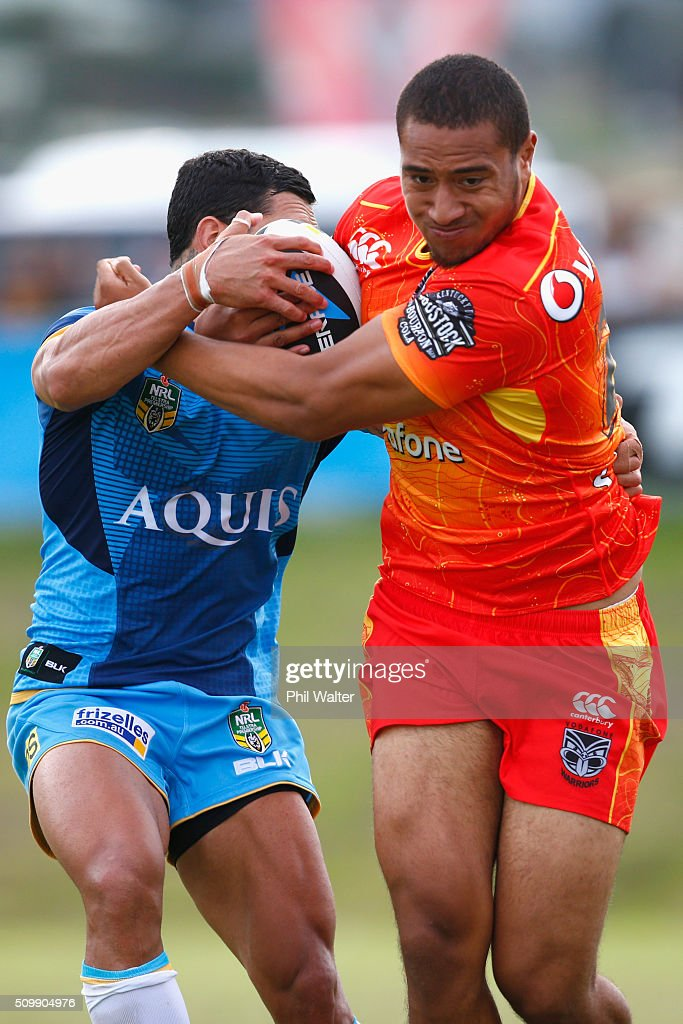 Ofahiki Ogden of the Warriors is tackled during the NRL Trial Match between the New Zealand Warriors and the Gold Coast Titans at Toll Stadium on February 13, 2016 in Whangarei, New Zealand.
