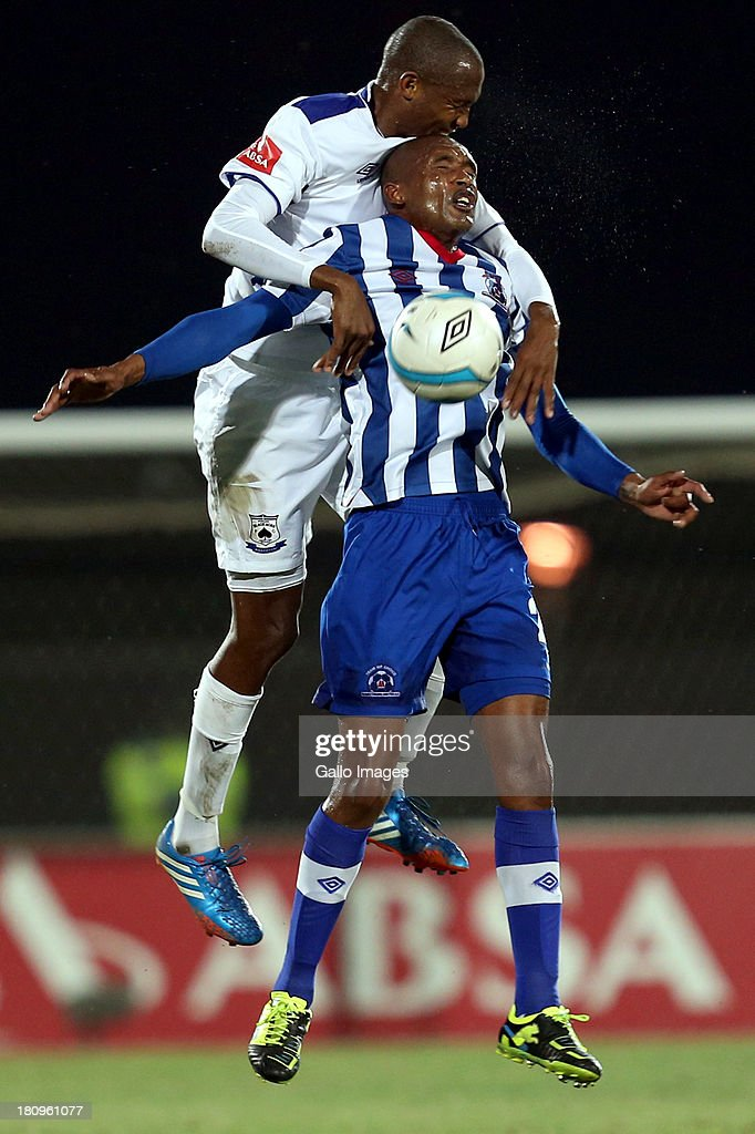 Ofentse Nato of MP Black Aces in action against Ashley Hartog of Maritzburg United during the Absa Premiership match between Maritzburg United and MP Black Aces at Harry Gwala Stadium on September 18, 2013 in Durban, South Africa.