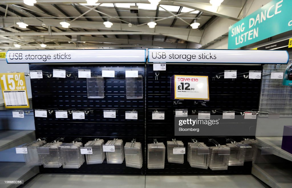 A '15% Off ' discount sign hangs near an empty display of USB computer storage sticks inside a Comet electronics store in Slough, U.K., on Friday, Nov. 23, 2012. Comet, a U.K. electronics chain, appointed Deloitte LLP as insolvency administrator, less than a year after being bought by private-equity firm OpCapita LLP. Photographer: Chris Ratcliffe/Bloomberg via Getty Images