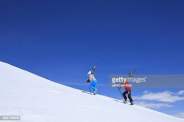 Off piste  Men and women snow skiers in powder snow