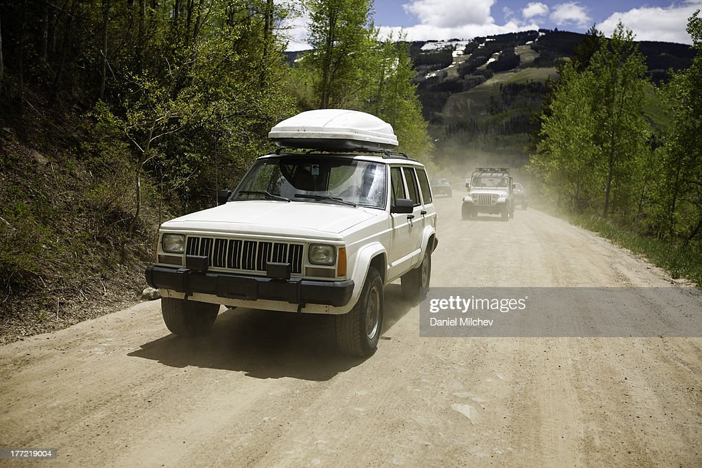 Off road vehicles on a dirt road in the mountains. : Stock Photo