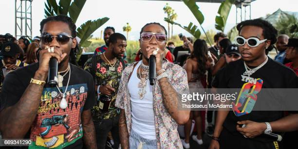Off Set Quavo and Take Off of the Migos perform at the Revolve Desert house on April 16 2017 in Palm Springs California