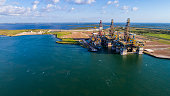 Off Shore Oil Drilling Rig being Deconstructed on Island on the Gulf of Texas