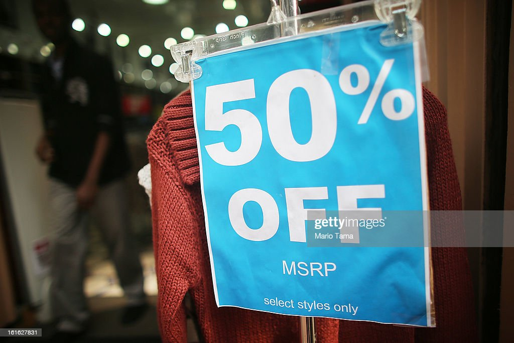 A '50% Off' sign is attached to a clothing rack at a store on Broadway in Manhattan on February 13, 2013 in New York City. The Commerce Department reported that retail sales were only up slightly in January following tax increases and high gas prices.