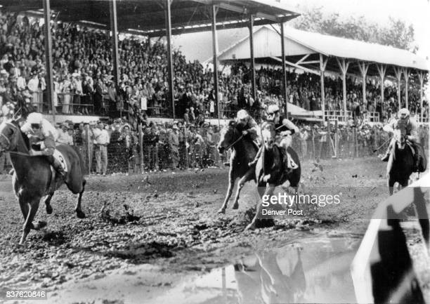 Off To A Flying Start High Flying owned by Andy Thomas and Piloted by Duane Robertson gets off to a flying Start in the mud before a packed...