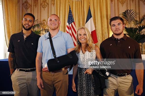 Offduty US servicemen Anthony Sadler Spencer Stone Alek Skarlatos and US ambassador to France Jane Hartley pose after a press conference at the US...
