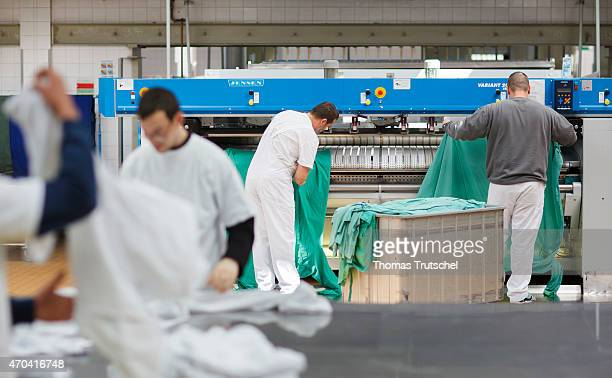 Offenders working in the laundry facilities of the prison Ploetzensee in the context of the pilot project work instead of punishment delinquents that...
