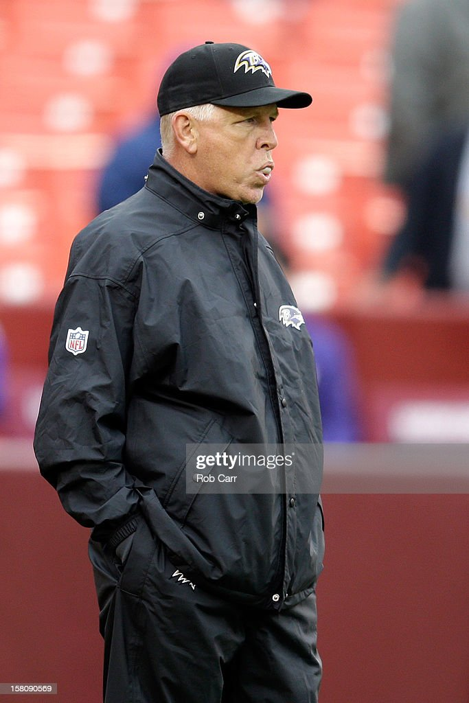 Offensive coordinator Cam Cameron of the Baltimore Ravens watches as the team warms up prior to the start of the Ravens game against the Washington Redskins at FedExField on December 9, 2012 in Landover, Maryland.